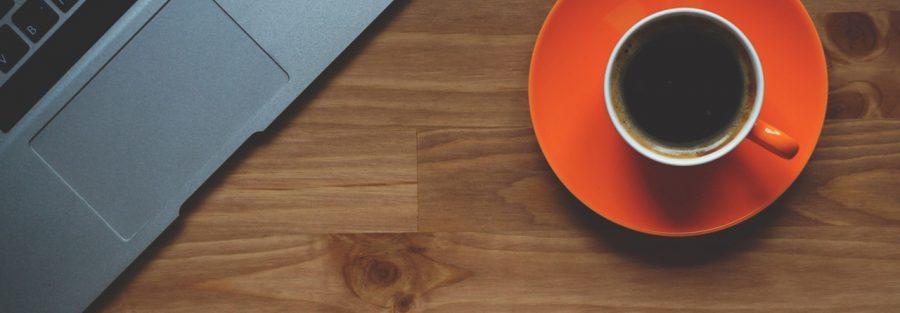 cup of coffee laptop office macbook